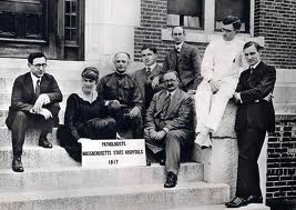 A photograph of pathologists at the Psychopathic Department of the Boston State Hospital. From left to right: Harry Solomon, Myrtelle Canavan, Abraham Myerson, Douglas Thom, Elmer Southard, Herbert Thompson, Lawson Lowrey, and William Rappleye.