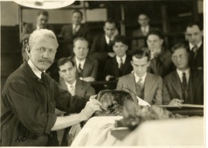 Robert M. Green performing an anatomical dissection  by Thomas Woolstone Dixon, circa 1929. Harvard Medical Library in the Francis A. Countway Library of Medicine [0002651]