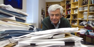 Max Essex, the Mary Woodard Lasker Professor of Health Sciences at his desk at HSPH. Jon Chase/Harvard Staff Photographer