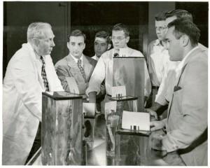 Dr. A. T. Hertig, Dept. of Pathology, HMS, using specimens to teach medical students.