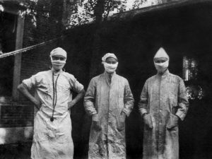 Three doctors at the Peter Bent Brigham Hospital in Boston, MA outfitted for handling the influenza epidemic of 1918.