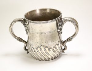 "Photograph of a stemless sliver loving cup with the engravings ""Oliver Wendell Holmes"" and ""The Pledge of Friendship"""