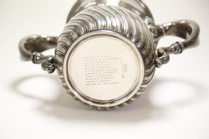 Photograph of the bottom of the cup showing the eleven names engraved there: Helen C. Bell, Marianne Brimmer, Susan Cabot, Annie Fields, Alice G. Howe, Elizabeth Howes, Sarah O. Jewett, Mary G. Lodge, Minnie C. Pratt, Cora L. Shaw, and Sarah W. Whitman